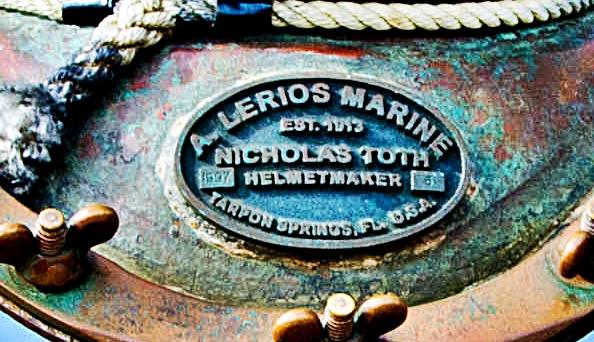 Distinctive Cigar - Retired Diving Helmet on Rainforest Marbel Stand with Royale Cigar Ashtrays1